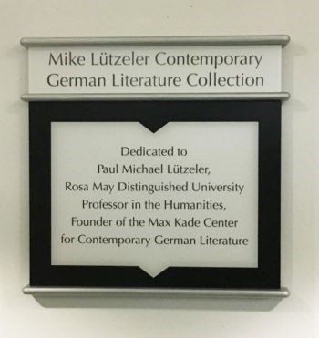 """A plaque that says """"Dedicated to Paul Michael Luetzeler, Rosa May Distinguished Professor in the Humanities, Founder of the Max Kade Center for Contemporary German Literature"""""""