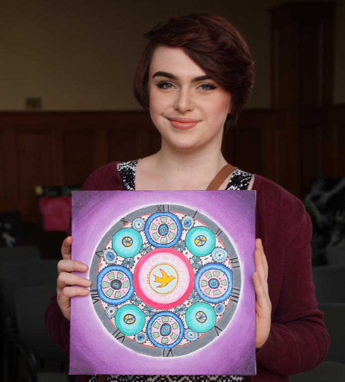 student holding art