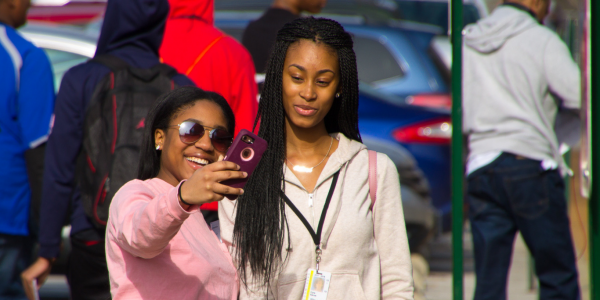 Two high school students take a selfie before the German Day events officially begin.