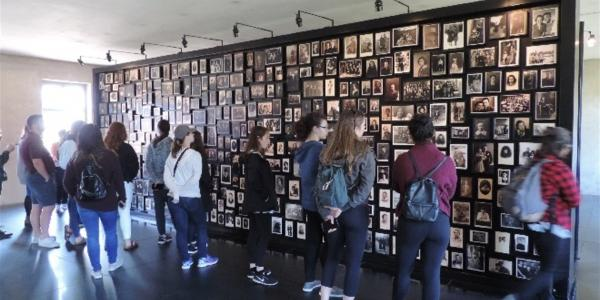 Students viewing the exhibition of photos found among the possessions of Jews deported to Auschwitz-Birkenau