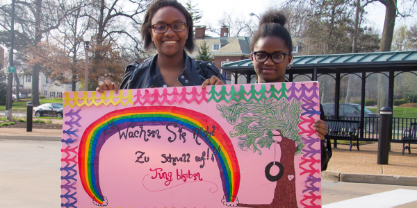 Two students proudly hold the poster they will enter in the 2018 German Day Poster Contest.